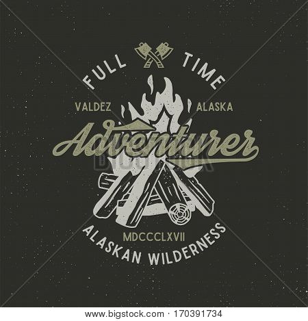 Full time adventurer vintage label with textured bonfire, axe and type elements. Alaska wilderness retro emblem. Vector letterpress effect