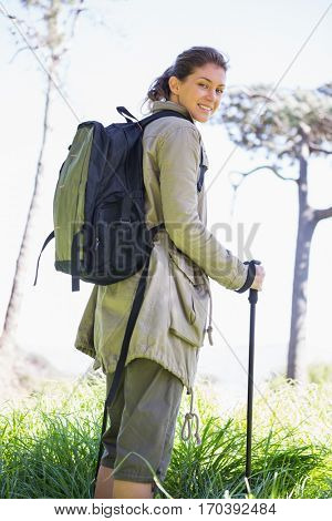 Woman with hiking sticks in the countryside