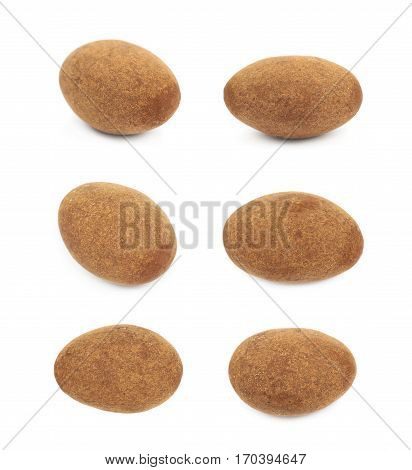 Chocolate coated almond nut isolated over the white background, set of six different foreshortenings