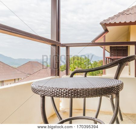 rattan chairs on balcony of backside room to look nature view