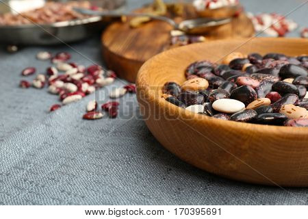Closeup of bowl with haricot beans on table