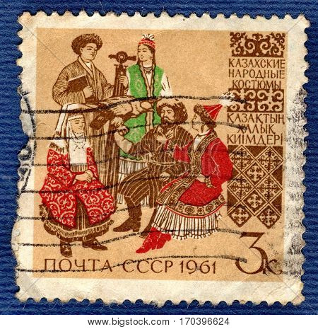 USSR - CIRCA 1961: Postage stamp printed in USSR shows image of musicians and dancers in Kazakh traditional and historic folk costumes, from the series