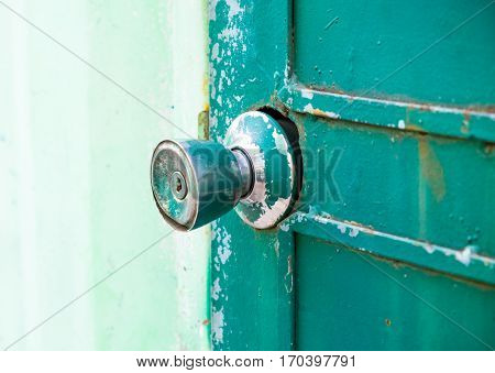 Old door knobs with a steel door.