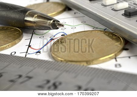Financial background with money calculator graph and pen.
