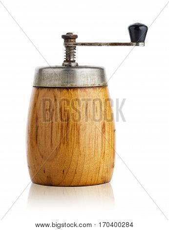 Old pepper mill with handle isolated on white background