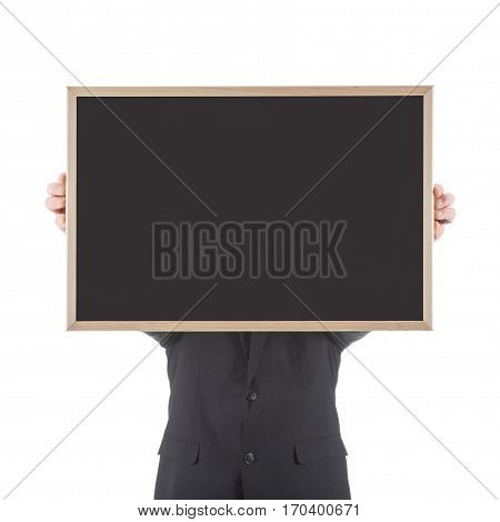 Business man holding empty chalkboard before his head isolated on white background