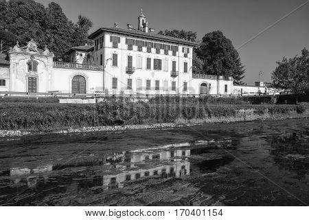 Cassinetta di Lugagnano (Milan Lombardy Italy): facade of the historic Villa Visconti Maineri along the canal known as Naviglio Grande of Turbigo. Black and white