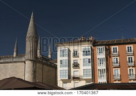 Burgos (Castilla y Leon Spain): exterior of the medieval cathedral in gothic style and facade of residential buildings