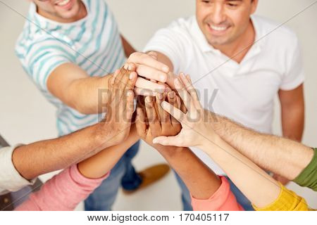 diversity, race, ethnicity, gesture and people concept - international group of happy smiling men and women making high five