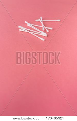 cotton swabs and sponge. Hygiene Red background