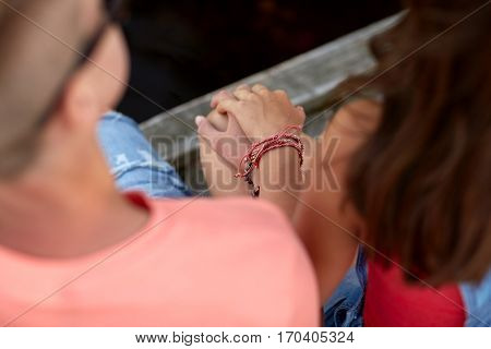 love and people concept - close up of happy teenage couple hands