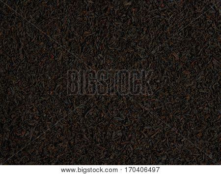 Heap of black tea scattered on the surface for the background