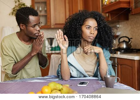 Young African Male Begging His Girlfriend To Forgive Him. Husband Asking His Pretty Wife For Forgive
