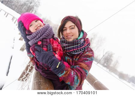 Happy family in winter forest at afternoon