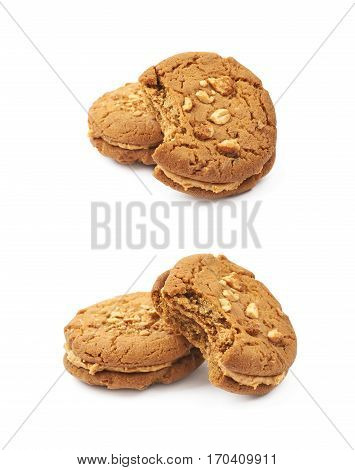 Two peanut butter homemade cookies with a bite taken of it, composition isolated over the white background, set of two different foreshortenings