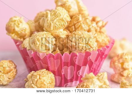Popcorn on the table. Paper cup with popcorn