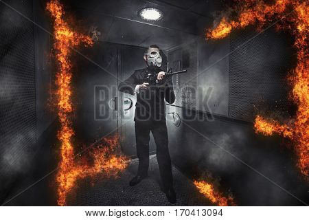 A man in a gas mask with a rifle in the old elevator
