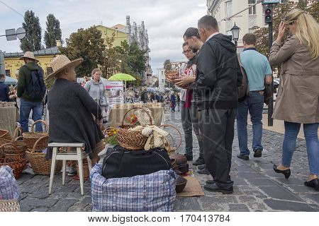 Kiev Ukraine - August 24 2016: Tourists visiting the souvenirs Wicker Andrew's descent in the street