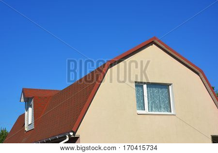 Exterior House Attic Dormer Window and Roofing Construction.