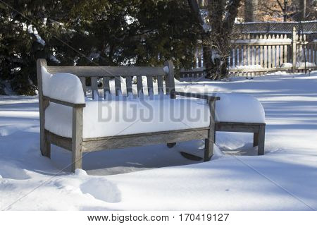 back yard garden seat in the snow