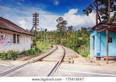 Railway crossing in Sri Lanka town .