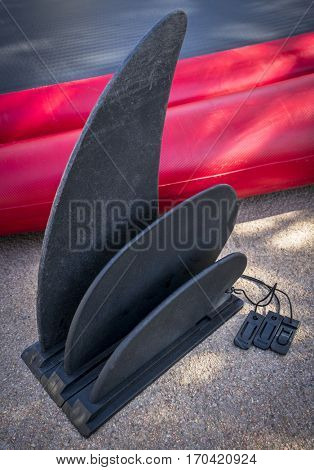 a set of fins for inflatable paddleboard of different length including short ones for rocky whitewater