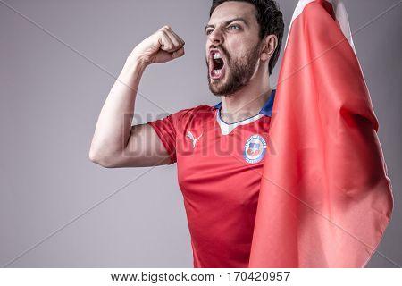 CHILE, SANTIAGO - CIRCA JAN 2017: Chilean soccer fan celebrating
