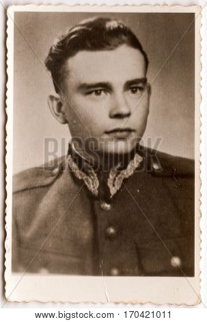 PIESZYCE, POLAND, CIRCA 1960's: Vintage photo of a soldier in uniform