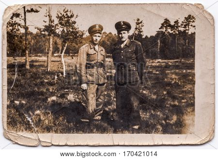 PIESZYCE, POLAND, CIRCA 1950's: Vintage photo of  two soldiers outdoor