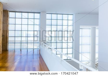 Balcony with wooden floor against glass block wall