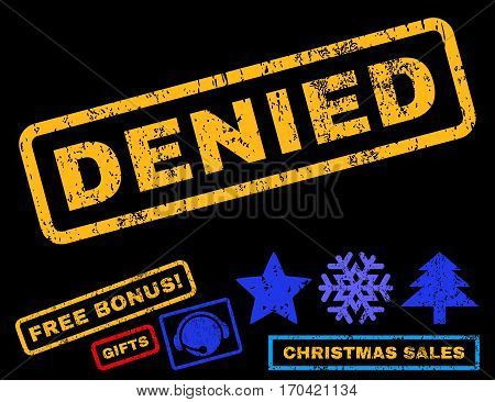 Denied text rubber seal stamp watermark with bonus christmas symbols. Tag inside rectangular banner with grunge design and dust texture.