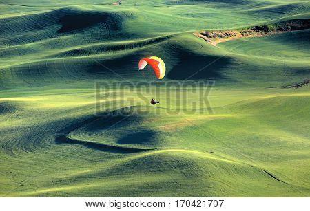 Para glider on rolling hills