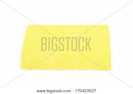 Piece of a sandpaper emery paper sheet, composition isolated over the white background