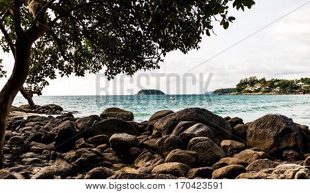 view over andamans sea from Kata noi Phuket. With a rocky shore