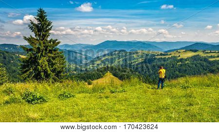 Photographer Taking Summer Mountain Landscape Pictures