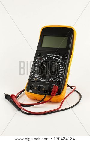 Digital multimeter with probes on the white background