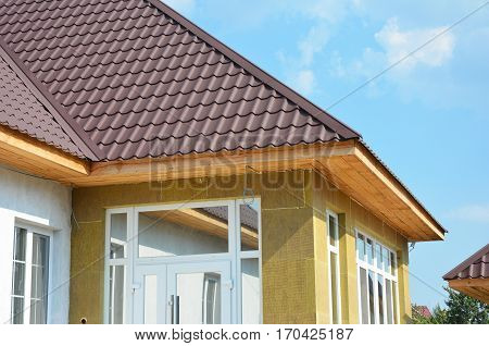 Roofing house and insulation detail. Building insulation exterior added to buildings for comfort and energy efficiency. Soffit and Fascia installation. Roofing Construction.