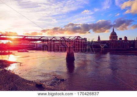 London St Paul Pauls cathedral sunset from Millennium bridge on Thames UK