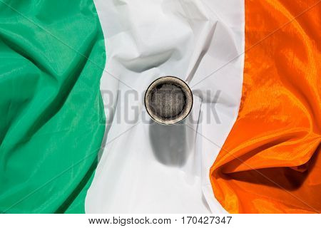 St Patrick day with a pint of black beer and irish flag seen from above