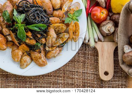 Seafood Pasta With Clams Black Spaghetti Vongole On White Plate On Wood Table Background