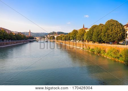 VERONA ITALY- September 08 2016: Scenery with Adige River Bridge Ponte Nuovo and the embankment of Adige River in summer evening.