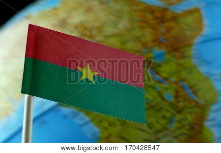 Burkina Faso Flag With A Globe Map As A Background Macro