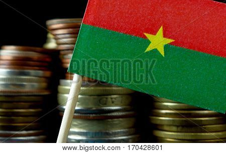 Burkina Faso Flag Waving With Stack Of Money Coins Macro