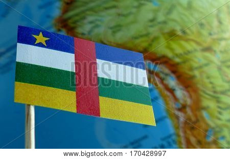 Central African Republic Flag With A Globe Map As A Background Macro