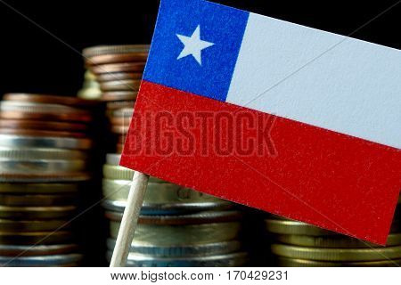 Chilean Flag Waving With Stack Of Money Coins Macro