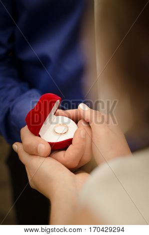 Young man makes a proposal to get married. Man hold marriage ring.love engagement