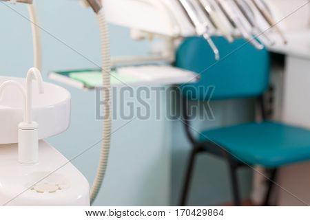 Stomatological instrument in the dentists clinic. Dental background: work in clinic. Operation tooth replacement.