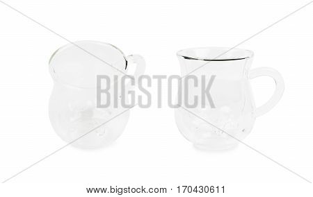 Cow's udder shaped glass cup isolated over the white background, set of two different foreshortenings