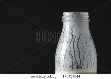 Dripping kefir on the walls of the bottle horizontal