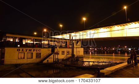 BELGRADE, SERBIA, JULY 2, 2014: Exterior night shot of a floating nightclub. Belgrade is famous for its floating restaurants and nightclubs on River Sava, Serbia.